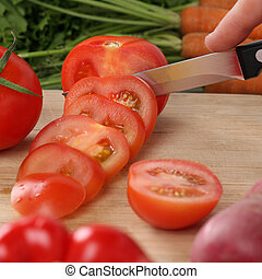 Healthy food tomato vegetables slicing on a kitchen board