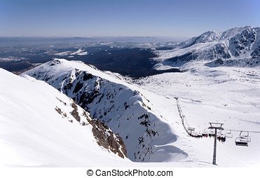 Skiing in Tatra Mountains in Poland - Ski runs and chairlift...