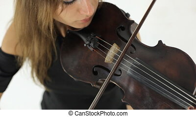Amazing girl playing the violin melody - Close-up of amazing...