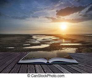 Beautiful vibrant Summer sunset over golden beach landscape...