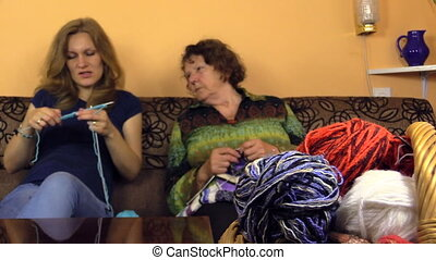 woman experience knit - grandmother check granddaughter knit...