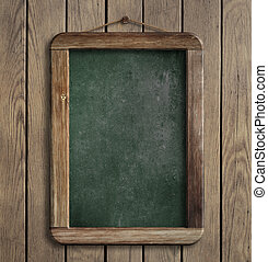 Aged menu blackboard hanging on wooden wall - Aged green...