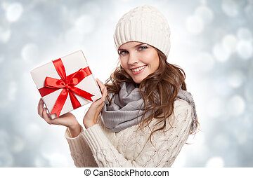 Young happy woman with a gift. Christmas.