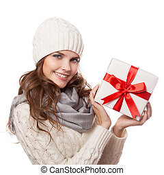 Young happy woman with a gift. Christmas. Isolated.
