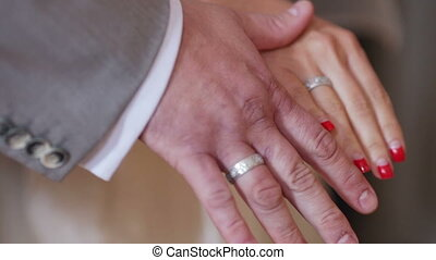 Wedding rings - Two white people groom and bride with...