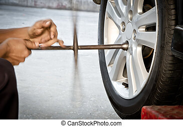 Replacing damaged wheel drive vehicle - Mechanic technician...