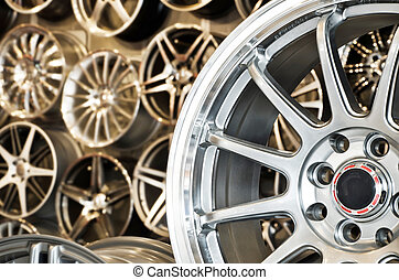 Various alloy wheels in store, selective focus