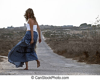 Escape - Lonely woman in middle of nowhere running away in...
