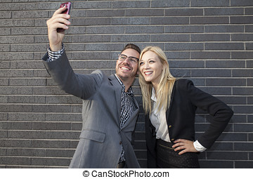 Young business team taking a selfie - Young business team...