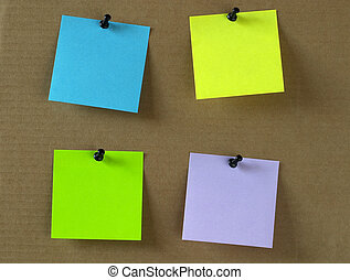 Sticker notes - Four colored empty sticker notes on a...