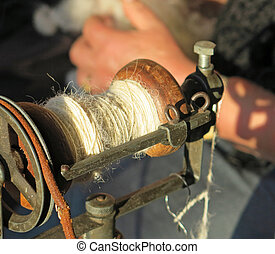 sewing thread in an antique spinning wheel