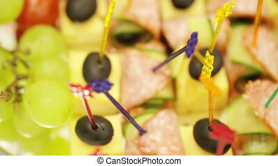 Light refreshments - On a dish are light snacks on skewers
