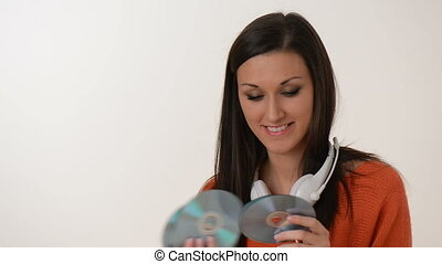 listen to music - young girl chooses her favorite audio CDs...