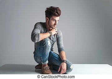 Attractive fashion man relaxing on the floor - Attractive...