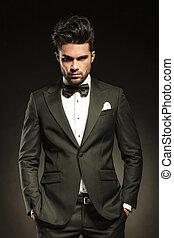 Handsome elegant business holding both hands in pockets. -...