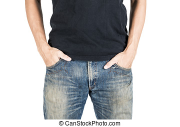 man with his hands in jeans pockets