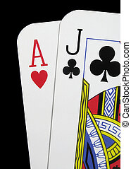 Close up of blackjack playing cards on a black background
