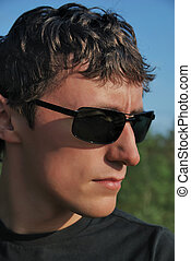 Young man in dark glasses.