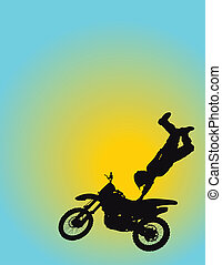 Motocross - Silhouette of a young man flying through the air...