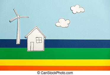 Home model and windmill on colorful background
