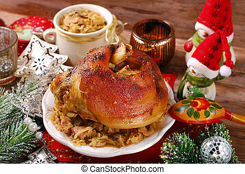 pork knuckle with sauerkraut for christmas dinner - roasted...