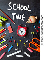 School time. School tools around. Blackboard background.