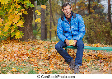 Man in the autumn park