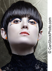 Emo girl with straight fringe bob and alternative make-up,...