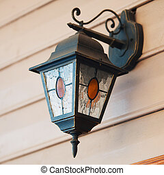 street lamp on building wall