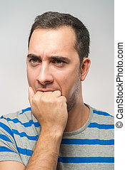 stressed mid adult man biting fingernails - stressed mid...