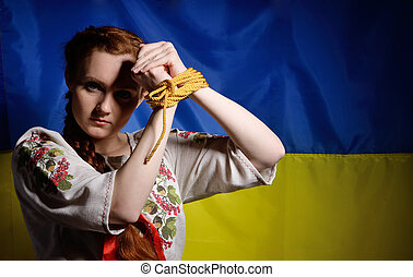 Ukrainian girl with hands tied - The young woman is rising...