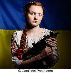 Ukrainian girl with a machine gun - The resolute young woman...