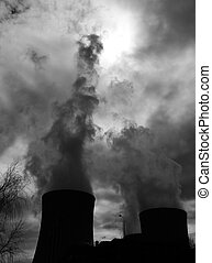 Cooling towers of a nuclear power plant creating dark clouds...