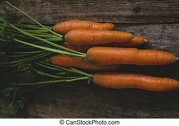 Carrots on the table - Delicious carrots on a wooden table
