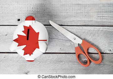 Canada cutting cost with a piggy bank overlaid by Canadian...