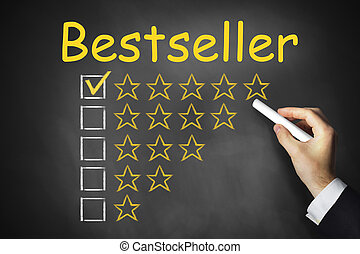 hand writing bestseller on black chalkboard golden rating...