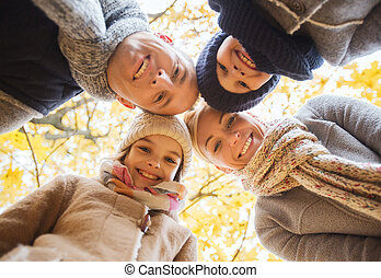 happy family in autumn park - family, childhood, season and...