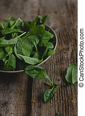 Spinach on the table - Food. Spinach on a wooden table