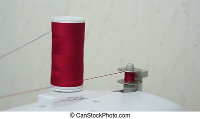Winding Up a Sewing Bobbin Thread - Close up shot of a...