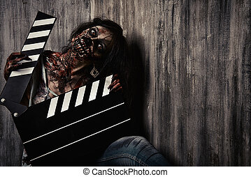 cinematography - Filming a horror movie. Female zombie...
