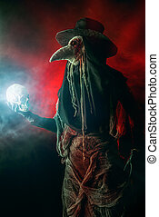 halloween simbol - Medieval plague doctor stands with a...