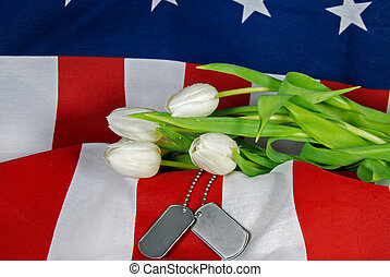 Military Tribute - Tulips and military dog tags on a flag.