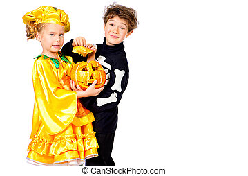trick or treat - Cute boy and a girl wearing halloween...