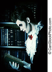 studying ancient books - Handsome vampire nobleman studying...