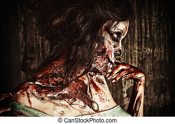 nightmare - Close-up portrait of a scary bloody zombie girl....