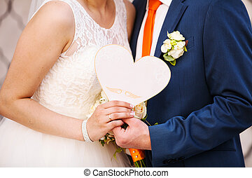 Couple in love with heart in hands