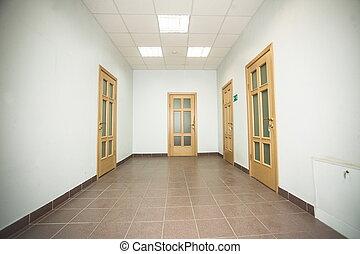 corridor with wooden doors