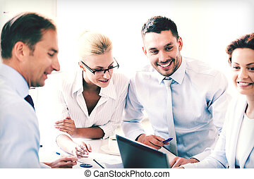 businesswoman with team on meeting in office - smiling...