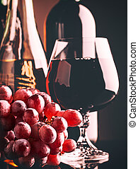 Retro style wine still life with grapes and beverages on the...