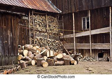 Wood storage near home. - Wood storage near home, visible...